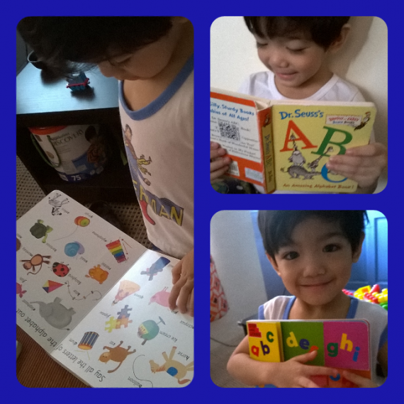 My little boy busy reading :)