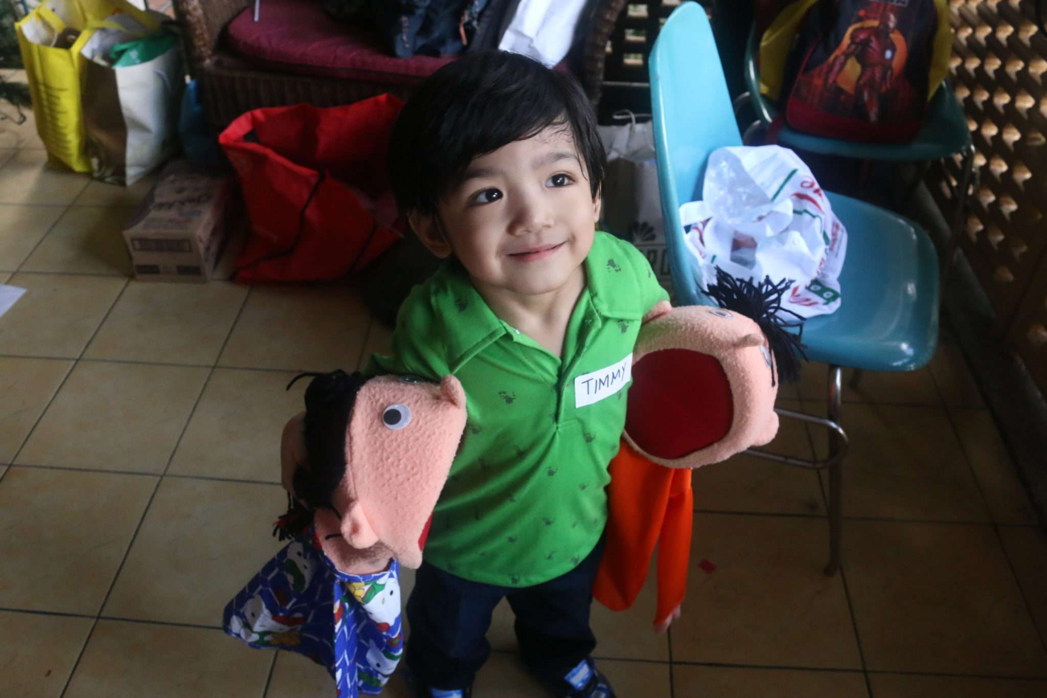 Our little boy is the official caretaker of the puppets Danny and Debbie :)