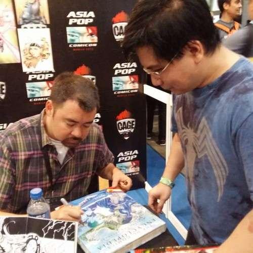 "Hank Kanalz signing hubby's ""DC Encyclopedia."" :)"